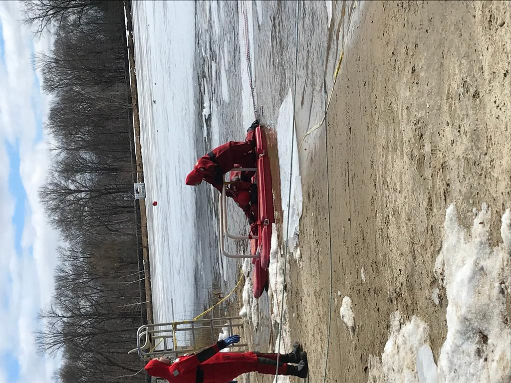 Our 2 newest members Austin Kottoor and Alyson Kaplan practicing ice rescue techniques.